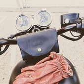 """Did you know this ? Our Waist bag is free to hang wether on your leather belt or the bars of your bike ? Just hang it wherever you like, and bring your essentials with you, hands free !  . . Le saviez-vous? La pochette cuir Wildust, complément de la ceinture cuir, est mobile, et peut s'accrocher ou bon vous semble! Sur le guidon, à coté de la selle... Emmenez vos essentiels avec vous, elle vous suit partout ! . . . #waistbag #beltbag """"leathergoods #madeinfrance #handsfree #purse #leatherpurse #ridelikeagirl #ridingaccessory #ridefree #womanrider #bikergirl #motogirl . ."""